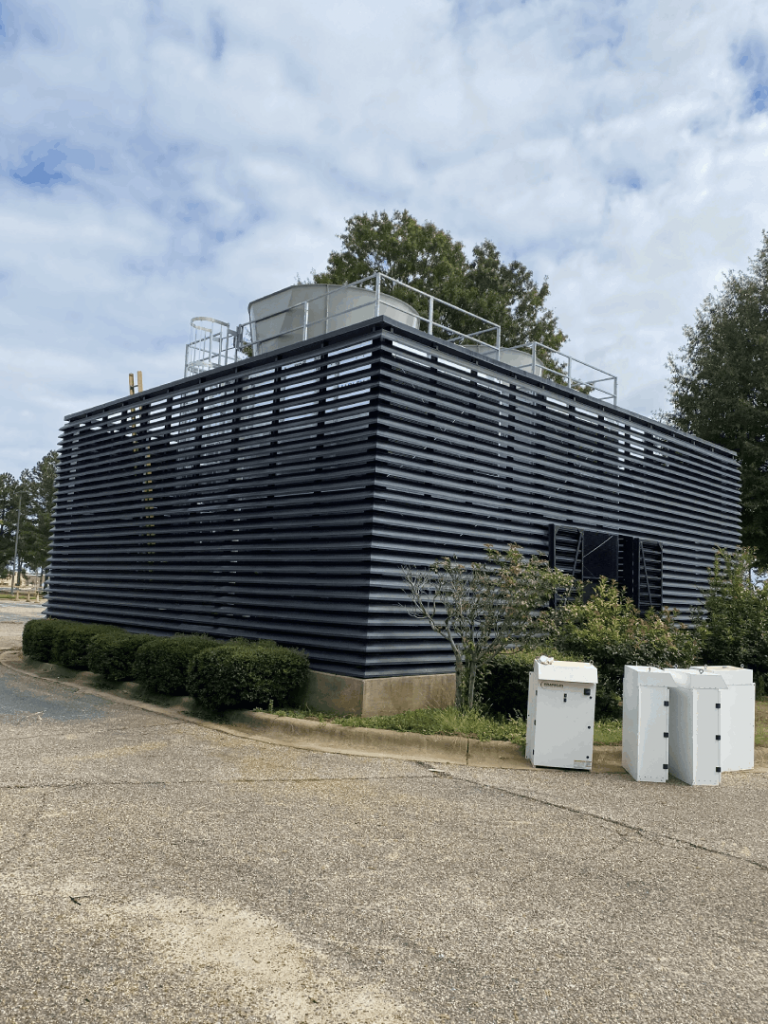 A picture of a cooling tower.
